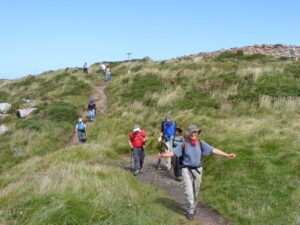Walkers on the South west Coast path with Letsgowalking