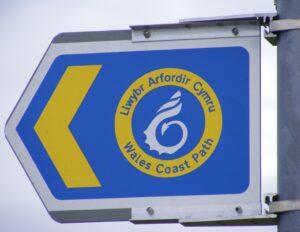 wales coast path sign on Post walking holidays wales letsgowalking
